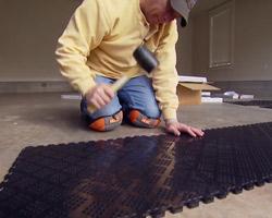 Installing Norsk PVC garage floor tiles.