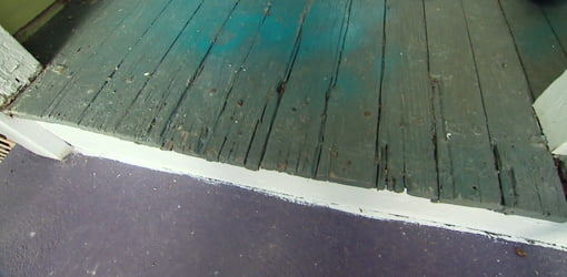 Rotten porch flooring before replacement.