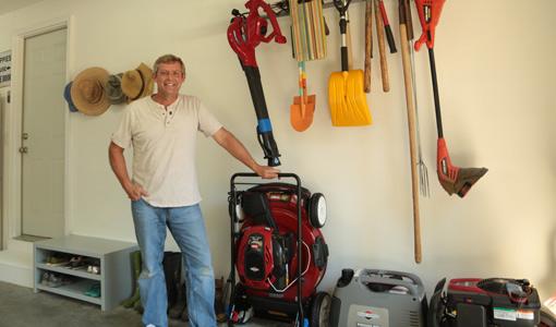 Allen Lyle in garage with Toro Recycler SmartStow lawn mower.