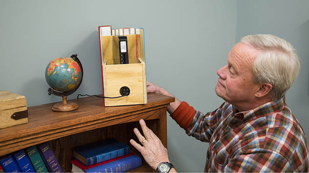 Old book covers disguise a wireless router.