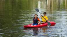boys canoeing in a lake