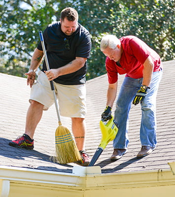 Chuck and Danny clean the roof and gutters.