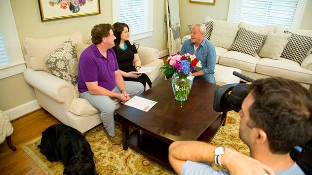 Danny Lipford goes over the fall checklist with homeowners Phillip and Kate Dekeyser.