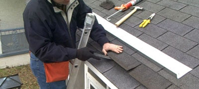 Prying the shingles.