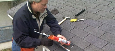 Use roofing cement to seal the rain diverter.