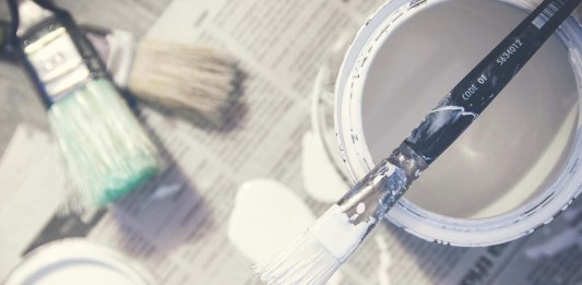 Paint brush on top of paint can