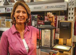 Jodi Marks, pictured with the Home Decorators Collection Portable Outdoor LED Wall Lantern Sconce