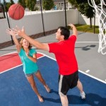 Couple playing basketball