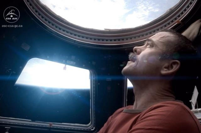 Former ISS commander Chris Hadfield witnesses lights turning into sound