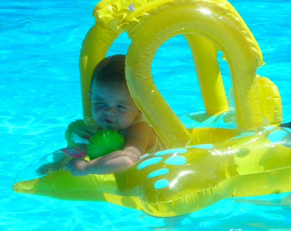 """Mia in the pool with her """"PopEye squint"""""""