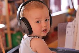 cut toddler with bluetooth headphone for plane