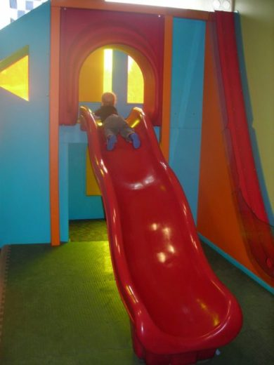 Children's Museum in Oak Lawn - red slide - Toddling Around Chicagoland
