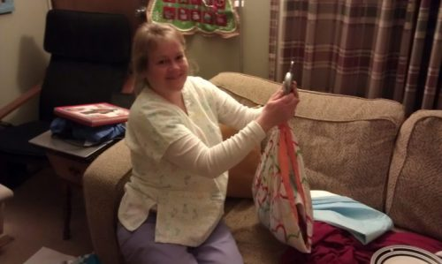 Home birth - nurse midwife Karen Bachman weighing baby