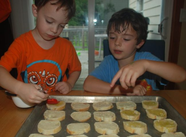Cooking Up Some Fun with Kidstir - Toddling Around Chicagoland - brushing olive oil