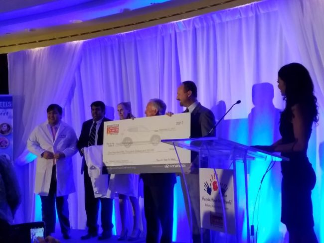 Check presentation to doctors from Hyundai Hope on Wheels