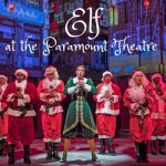 Elf and many Santas on stage during Elf at the Paramount Theatre