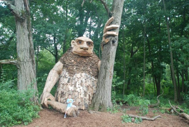 Giant troll by tree with boy