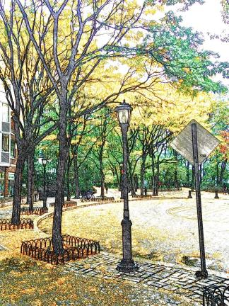 Leaves turning yellow, the same shade as the school buses, cabs and road markings
