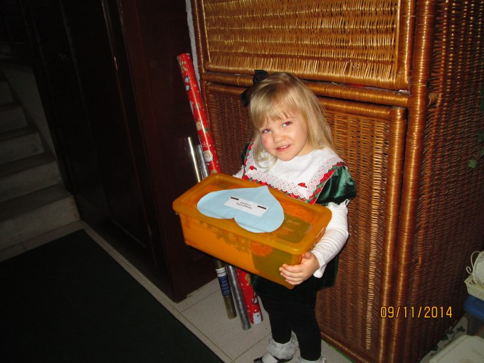 Taking her shoebox to church Sunday morning. This box is for a 3 year-old Roma girl.