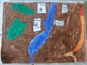 dibujo de un niño después de ver un video sobre la minería de oro en Kakavos. Las áreas marrones son el terreno sin plantas, el naranja es un río contaminado! Y los cráneos son los barriles con cianuro