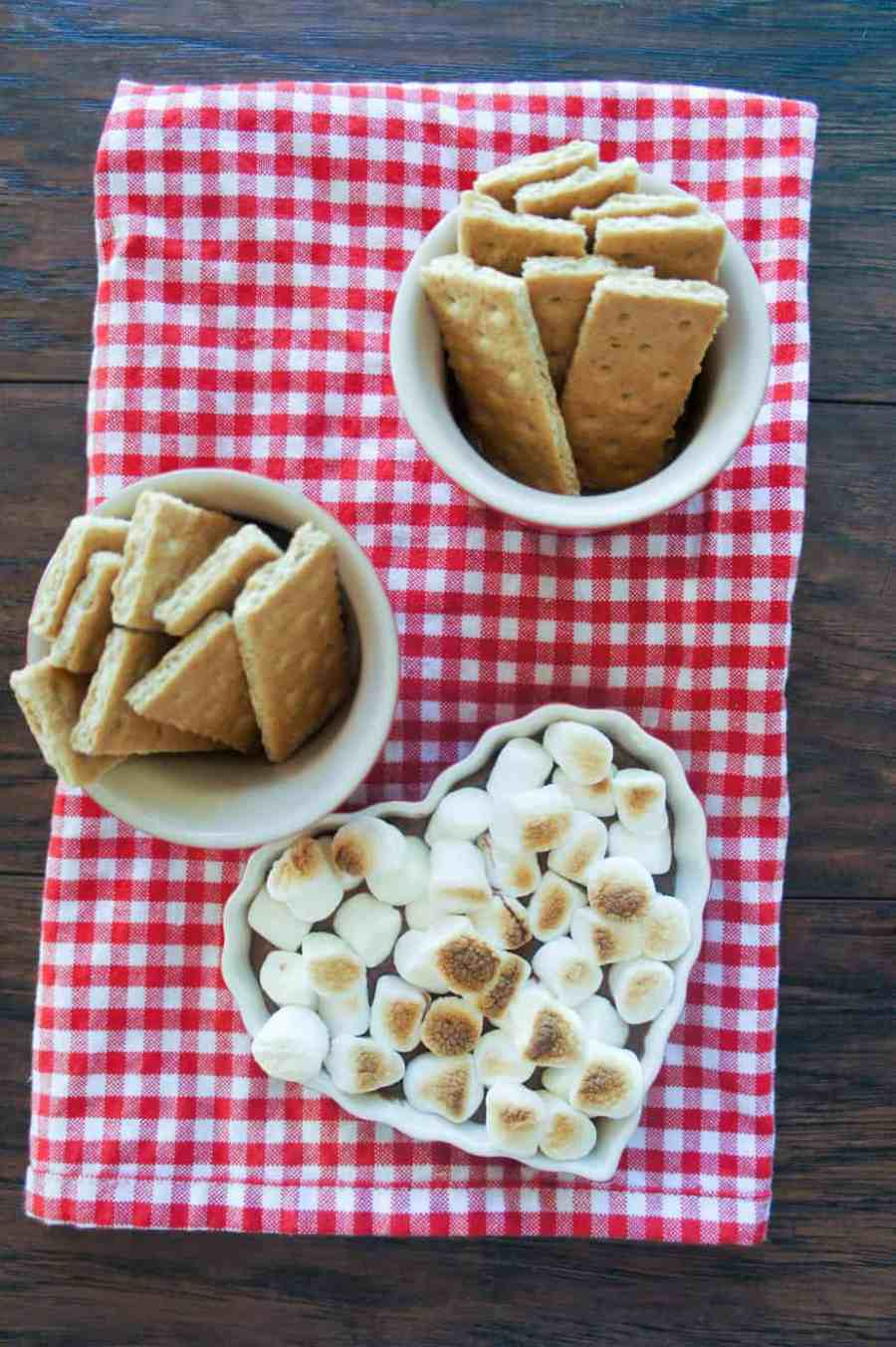 Campfire S'mores Dip is the perfect summer and fall treat. Whether you eat this indoors or outdoors, everyone is sure to enjoy this 3 ingredient, easy dessert!