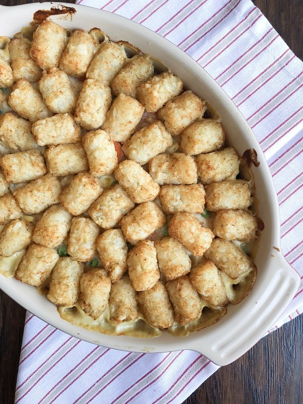 Tater Tot Chicken Pot Pie Hot Dish. The perfect Fall meal that is warm, comforting, delicious and full of hearty veggies and chicken!