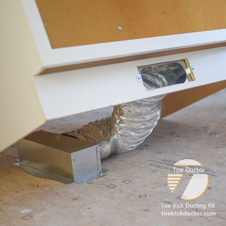 Toe Ductor Floor Vent Kit installed in cabinet toe kick