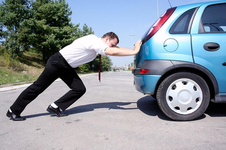 man pushing car - bad choices