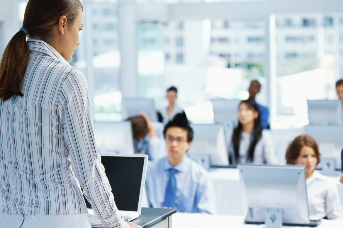 businesswoman training a group of business executives