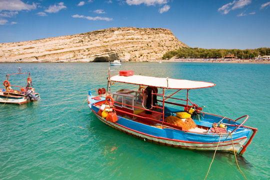 Fishing boat anchored in Matala bay, Crete, Greece