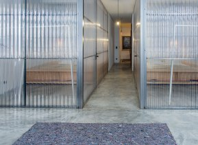 MissOpo-glass-partition-hallway-Remodelista