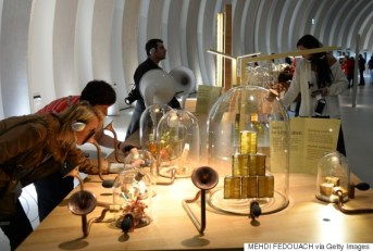 People take part in a sensory exhibit as they visit La Cite du Vin (Wine Museum) as it opens its doors to the public in Bordeaux on June 1, 2016. La Cite du Vin opened its doors to the public on June 1. The 13 350 m2 compound offers thematics areas about the history and civilisations of wine around the world with digital and sensory exhibits. / AFP / MEHDI FEDOUACH (Photo credit should read MEHDI FEDOUACH/AFP/Getty Images)
