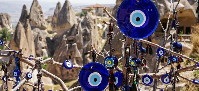a-vintage-tree-decorated-with-non-commercial-evil-eyes-pots-at-goreme-national-park-cappadocia-evil-eye-is-a-turkish-traditional-ornament-dating-back-to-paganism-1437579189-hdya