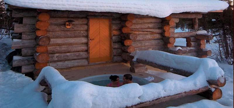 Kakslauttanen-Arctic-Resort-Luxury-Finland-Honeymoon-Packages-Queen-suites-private-jacuzzi