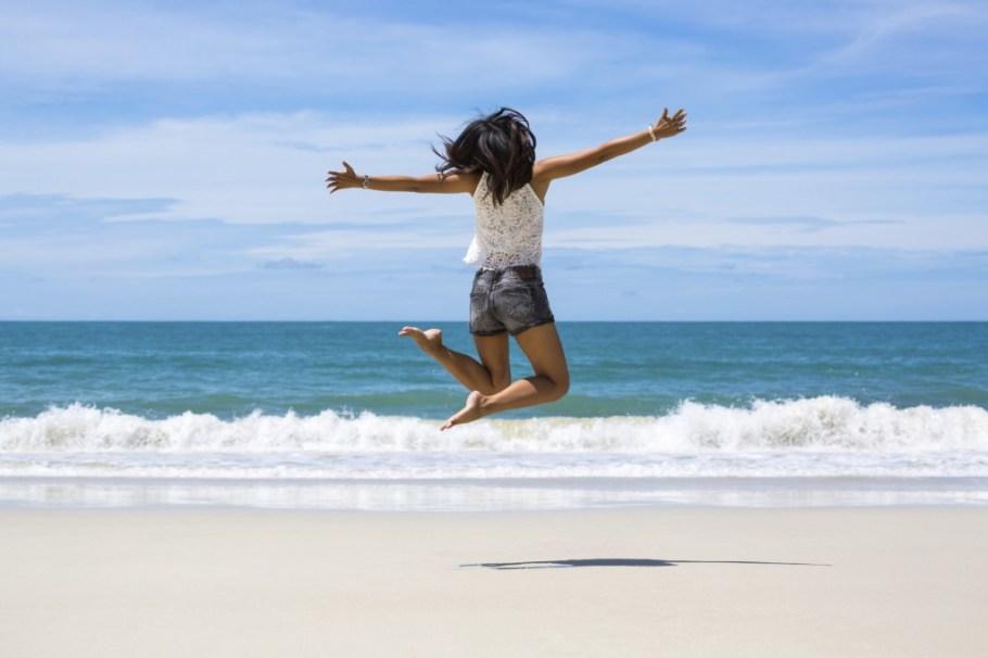 jumping-on-beach-istock_000068697271_medium-1024x682
