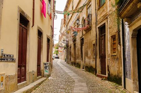 91948300-narrow-street-of-the-historic-center-of-coimbra-portugal-