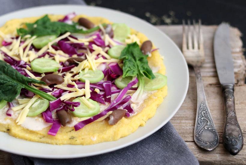 Quick polenta pizza with tahini sauce and raw veggies (vegan, gluten-free)