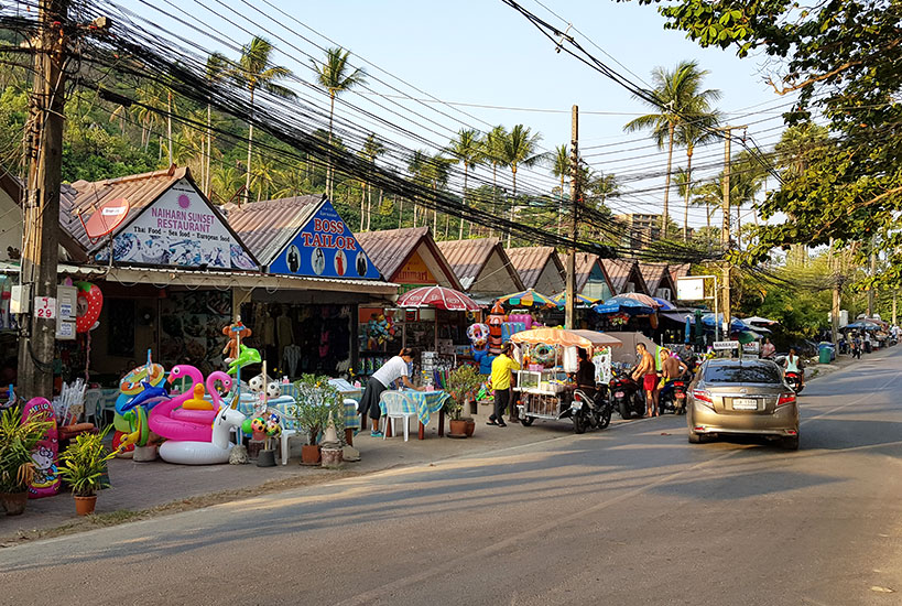 Colorful local restaurants and souvenir shops at Nai Harn Beach | Tofobo Family