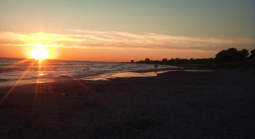Solnedgång och hav Tofta Strandpensionat