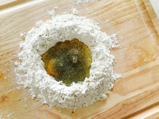 egg and flour well with herbs