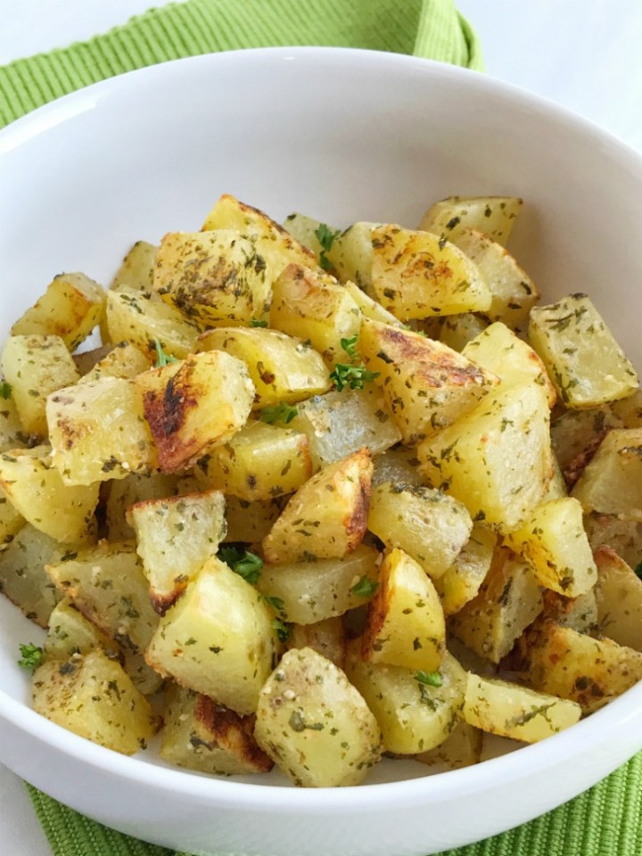 Parmesan roasted potatoes are crispy on the outside, soft and flavorful on the inside. Takes only minutes to prepare, a few ingredients and you have the most delicious side dish.