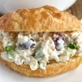 Chicken salad with sweet pineapple, red grapes, green onions, almonds, celery all covered in a creamy dressing. Serve in croissant rolls or in your favorite bread roll. Perfect for a summertime dinner because you don't even have to turn on the oven! These pineapple chicken salad sandwiches are a favorite of everyone that tries them.