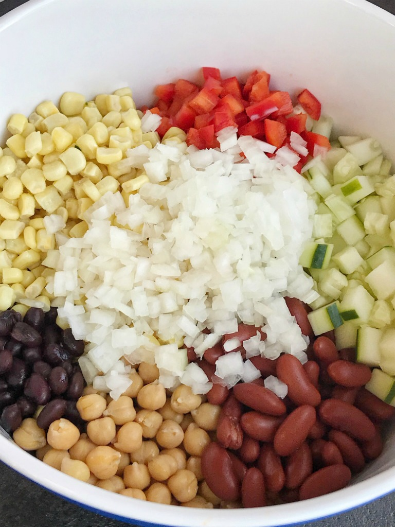 The Best Bean Salad | Salad | Side Dish | This really is the best bean salad ever! Easy, simple ingredients and fresh vegetables combine to make the tastiest, creamiest bean salad. Perfect side dish for a gathering, potluck, or BBQ. This bean salad uses convenient honey mustard salad dressing that gives it a creamy sweet flavor. #salad #sidedish #beansalad #easyrecipe