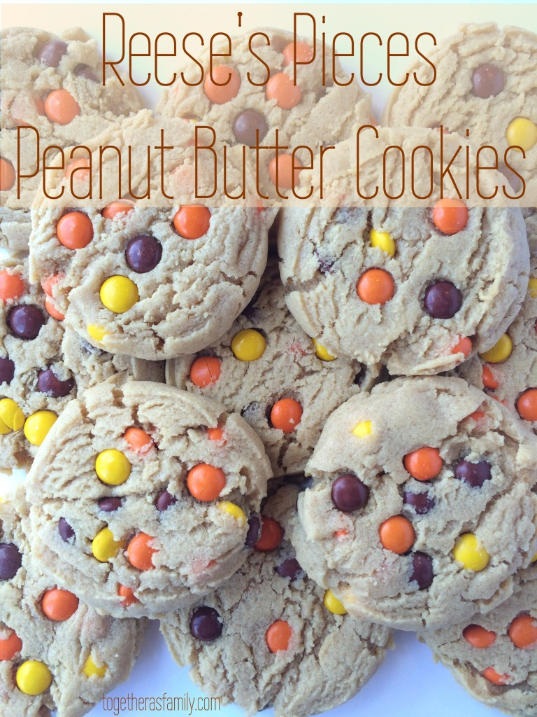 Reese's Pieces Peanut Butter Cookies- soft, chewy, and thick! Loaded with cute mini reese's pieces! www.togetherasfamily.com