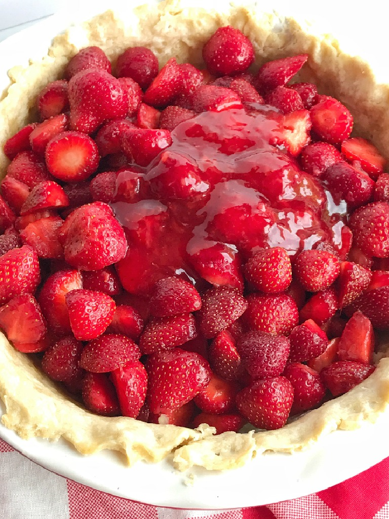 Fresh strawberry pie is loaded with lots of fresh strawberries covered in an easy, homemade strawberry gelatin. No Jell-O mixes required! Serve with some freshly whipped cream and you have a lighter dessert that is perfect for summer!