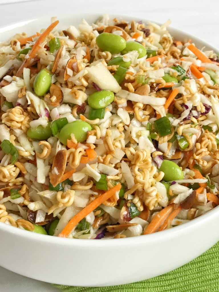 Crisp coleslaw lettuce, toasted golden brown ramen noodles and almonds, green onion, and shelled edamame all drizzled with a delicious seasoned sweet dressing! This asian ramen noodle salad is sure to be a hit.