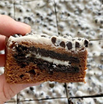 Cookies & Cream Oreo Brownies start with the best homemade brownie recipe, stuffed with Oreo cookies, and frosted with Hershey Cookies & Cream Chocolate bars!