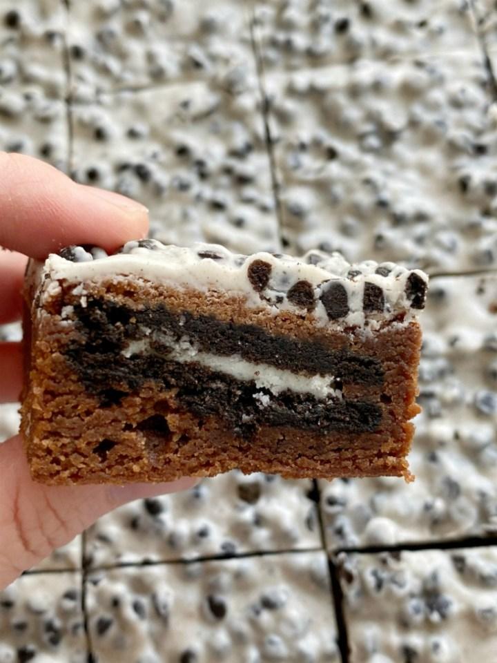 Cookies & Cream Oreo Brownies start with the best homemade brownie recipe, stuffed with Oreo cookies, and frosted with Hershey Cookies & Cream Chocolate bars!