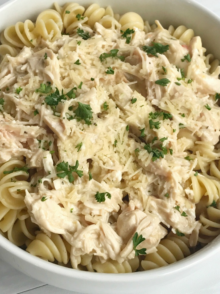 Slow cooker creamy Italian chicken is an easy and creamy delicious dinner. It's a dump & go slow cooker meal that takes just minutes to prepare and then it's ready when you are. The chicken is fall apart tender and it makes the most amazing creamy Italian sauce. Serve over pasta for a delicious dinner.