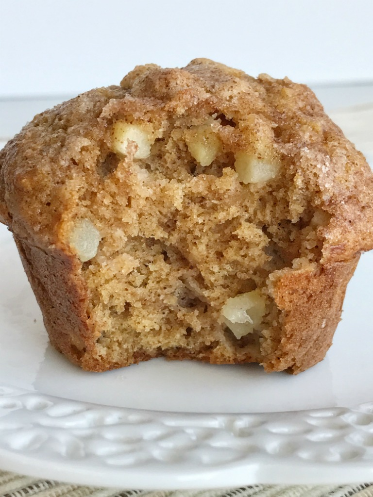 Soft cinnamon apple cider muffins loaded with chunks of apple and topped with a generous helping of cinnamon & sugar! These muffins will make your house smell amazing. These muffins are a must make recipe for Fall | www.togetherasfamily.com #muffinrecipes #applecider #cinnamonmuffinrecipes